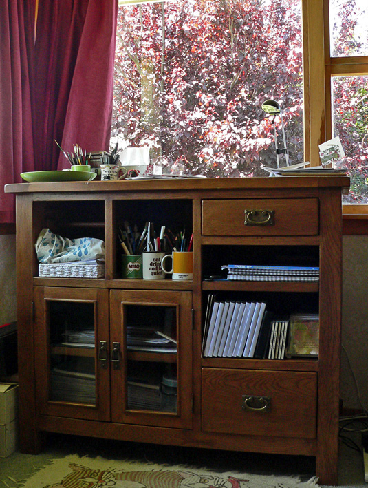 My new workbench and the view of our beautiful plum tree.