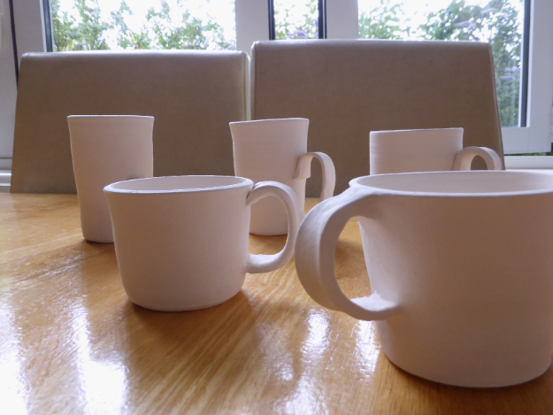 Della's Pottery mugs waiting to be decorated